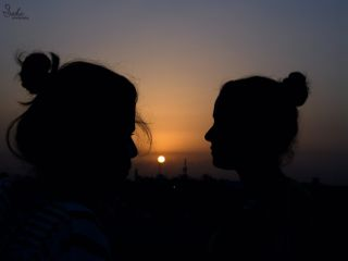 dawn sunrise silhouette girls sun